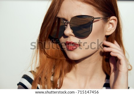 woman in sunglasses on the background of a building portrait