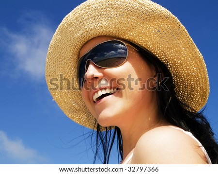 woman in sunhat on the blue sky - stock photo