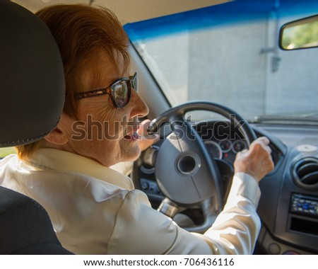 Woman in the Age of Driving a Car. Age Eighty Years. Old Woman.