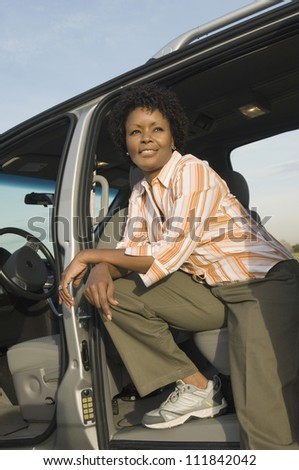 Woman in the car and looking away