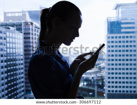 Woman in the city using her phone.  - stock photo