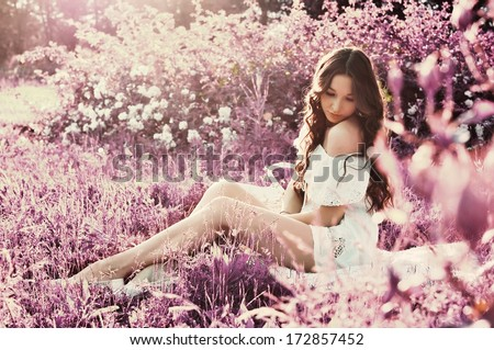 Woman in the garden - stock photo