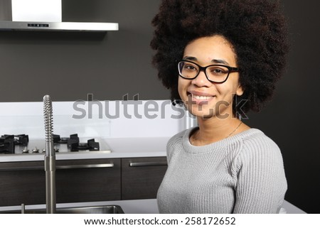Woman in the kitchen - stock photo