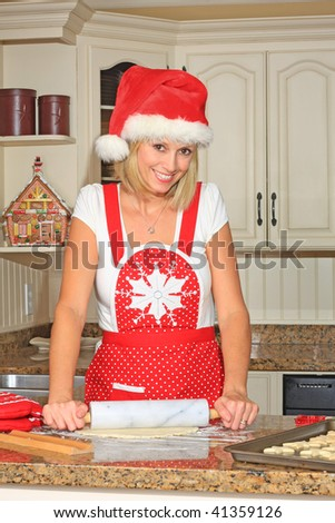 Woman in the kitchen making shortbread cookies. - stock photo