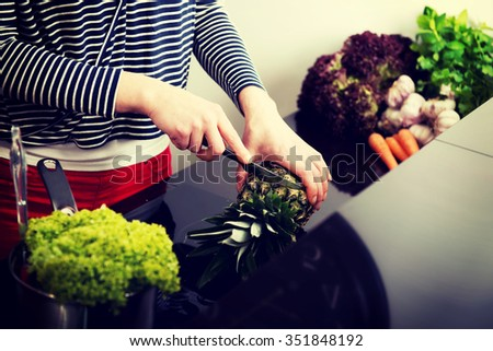 Woman in the kitchen preparing some healthy food. - stock photo