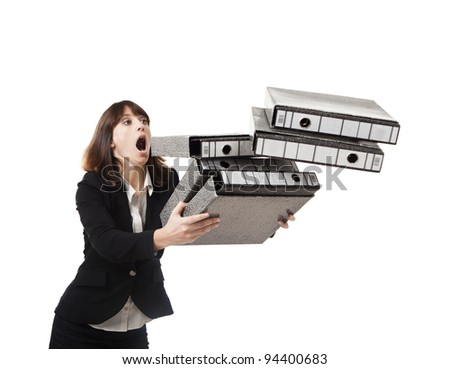 Woman in the office stumbling with a pile of folders in the hands, isolated on white - stock photo