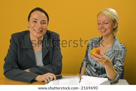 Woman in the office with an apple