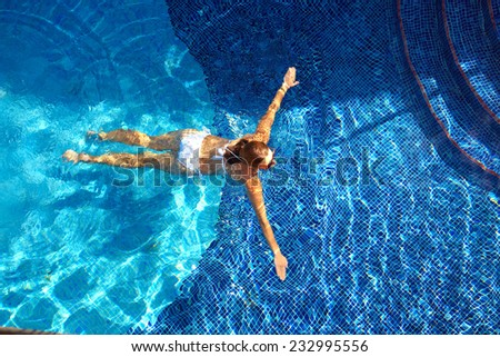 Woman in the pool. Vacation at caribbean resort        - stock photo