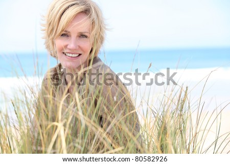 Woman in the sand dunes - stock photo