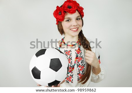woman in the Ukrainian suit holds the ball