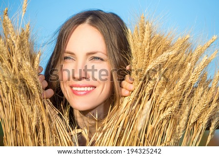 Woman in the wheat field. closeup portrait - stock photo