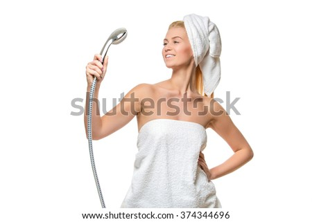 Woman in towel singing using shower head   - stock photo