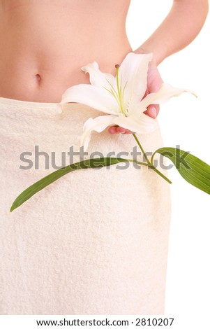 woman in towel with lily isolated on white - body care