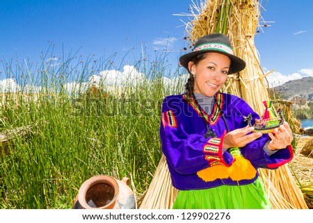 Woman in traditional clothes, lake Titicaca Puno Peru South America - stock photo