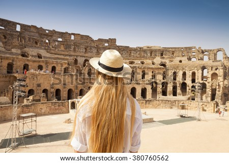 Woman in Tunisia El Jem roman apmphitheatre. Largest colosseum in in North Africa. El Jem,Tunisia. UNESCO - stock photo
