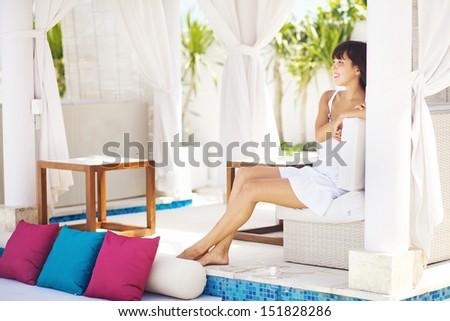 woman in villa interior - stock photo