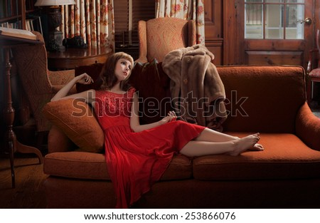 Woman In Vintage Styling on Couch