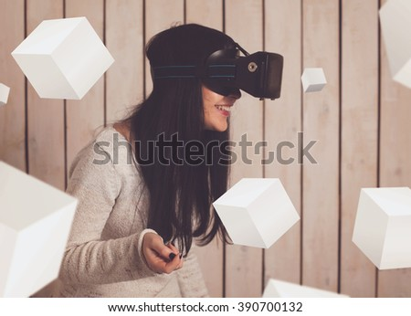 Woman in virtual reality helmet. VR glasses.