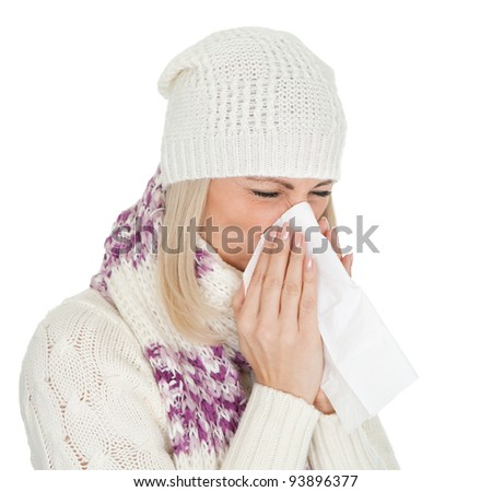 Woman in warm winter clothing sneezing from cold. Isolated on white - stock photo