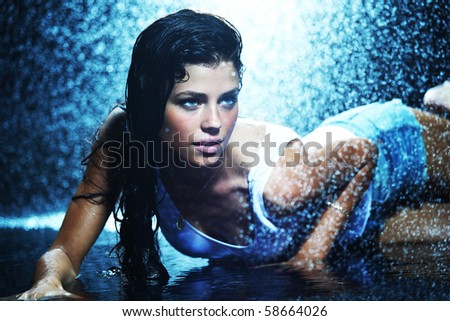 woman in water studio - stock photo
