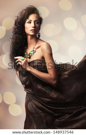 Woman in waving dress dancing with flying fabric - stock photo