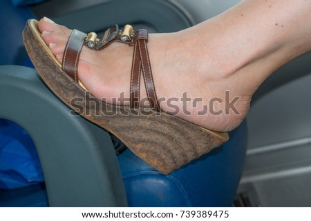 Woman In Wedges Shoes Relaxing Heel Feet On Chair