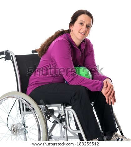 woman in wheelchair with ball - stock photo