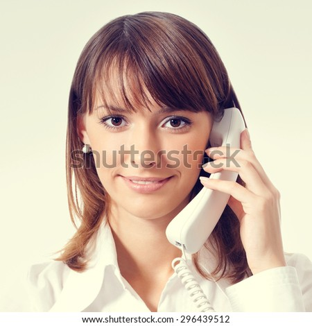 woman in white business style clothing or support phone worker - stock photo