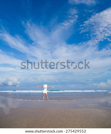 woman in white clothing refreshing at the ocean, bali Indonesia