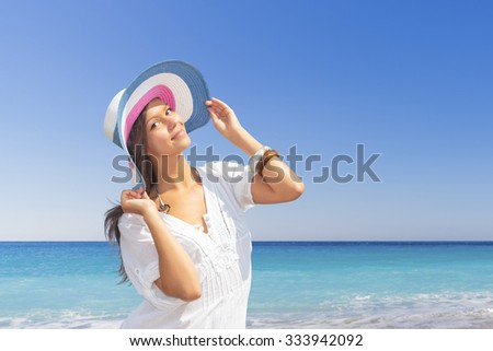 woman in white clothing refreshing at the ocean, Maldives - stock photo