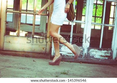 woman in white summer dress and high heel shoes outdoor shot summer day - stock photo