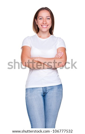 woman in white t-shirt standing with crossed hands