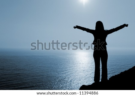 Woman in worship position. May be used for receiving, offering, praying and other abstract concepts. - stock photo