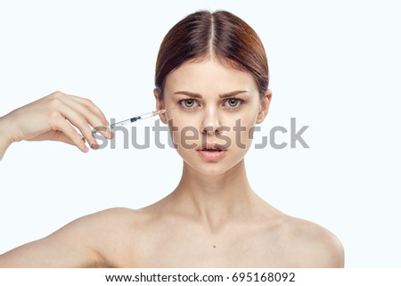 Woman injecting on face on isolated botox background