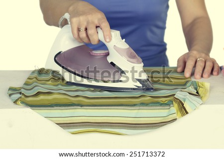 woman irons clothes