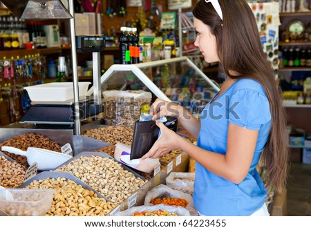 Woman is buying in food-shop - stock photo