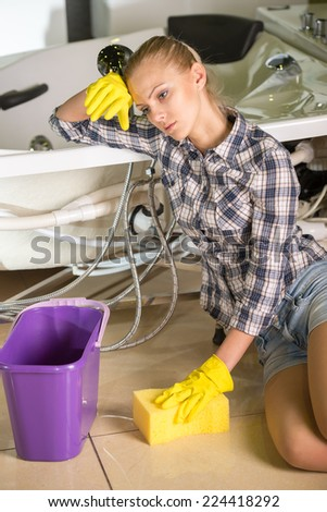 Woman is cleaning the floor. A bucket of water. - stock photo