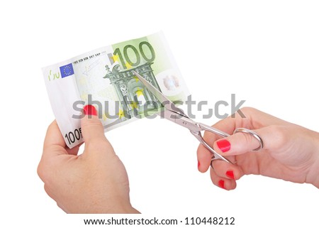 woman is cutting banknote with scissors - stock photo