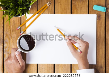 woman is drawing a something an empty paper