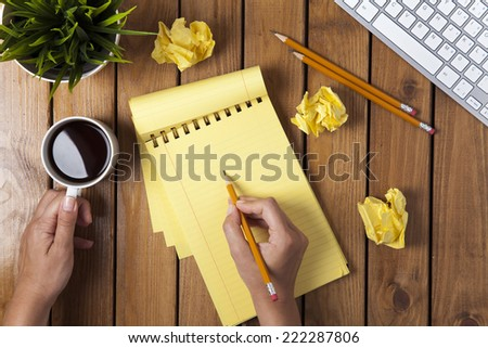 woman is drawing a something an empty paper - stock photo