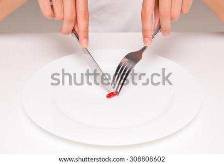 Woman is eating a pill. Concept of healthy food, diet. - stock photo