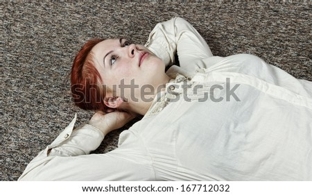 Woman is exercise on the floor.