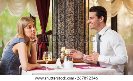 Woman is getting bored on first date - stock photo