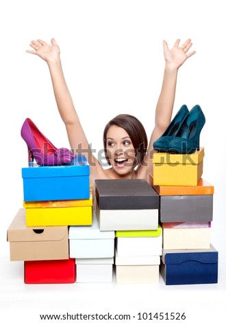 Woman is happy as she sees her shoe collection - stock photo