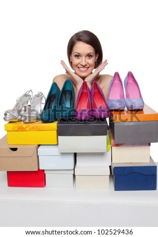 Woman is happy showing her shoe collection - stock photo