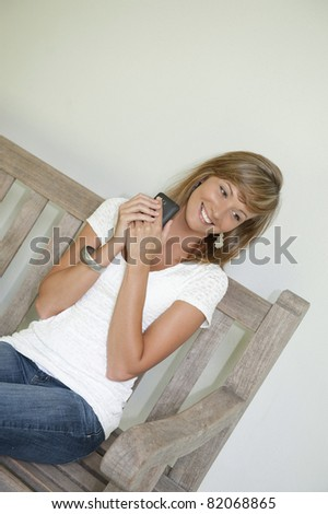 woman is happy with texting messages - stock photo
