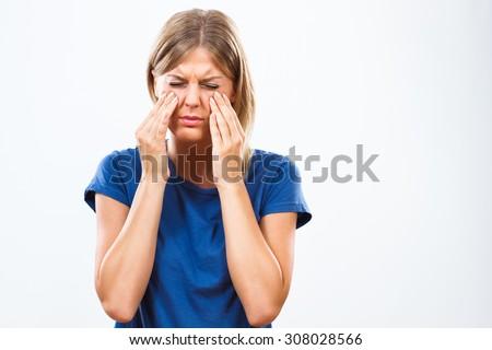 Woman is having pain in sinus.Sinusitis - stock photo
