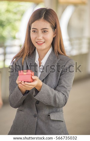 Woman is holding a gift box