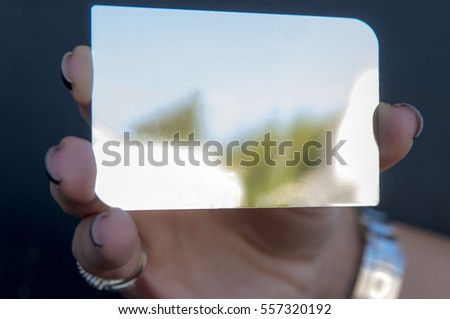 woman is holding a silver vip card