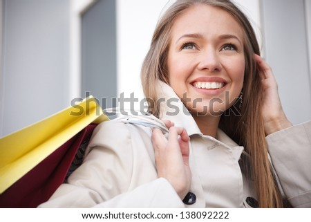 Woman is holding shopping bags.Selective focus